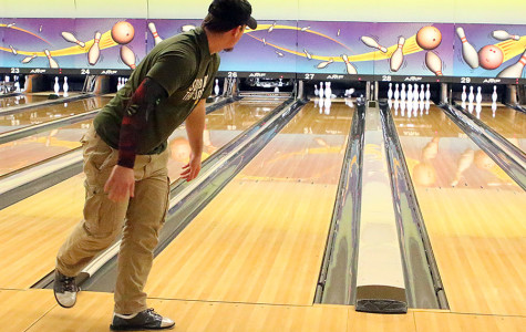 Father and son bond through bowling