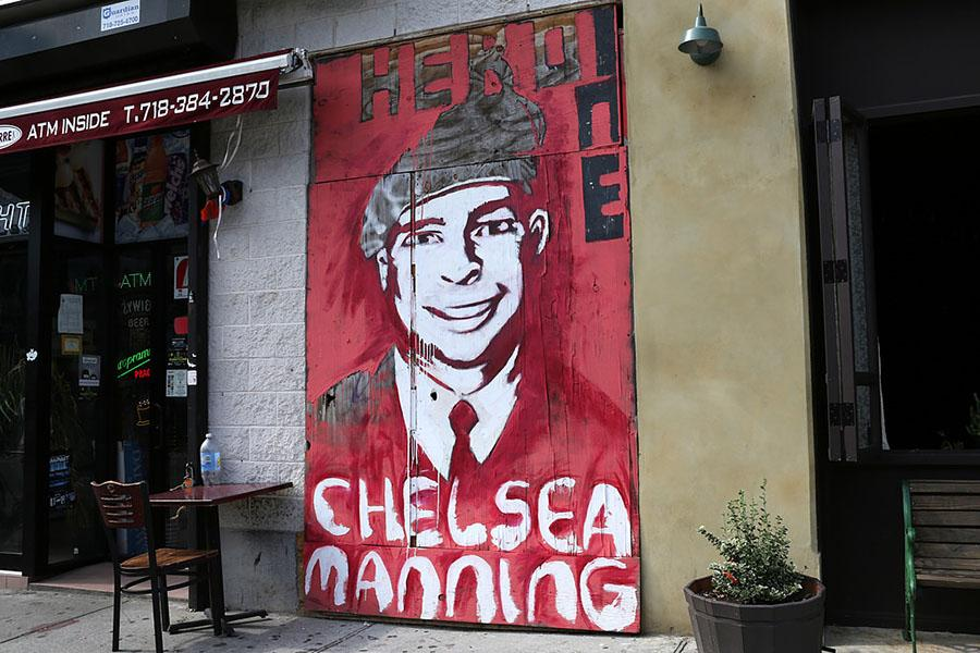 Sadly, this mural no longer exists, having been taken down (or covered over) by some newly-laid brickwork (quite similar to that in the picture to the left of the mural, behind the table). Chelsea Manning has been similarly removed-immured, locked away for years in the name of American justice.