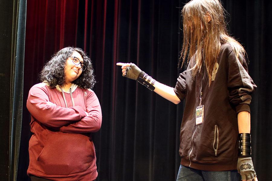 "Junior Celeste Castro (left) and senior Raymond Taylor (right) act out an excerpt from Drama Club's upcoming play ""Crumpled Classics"" in their sixth period Acting class."