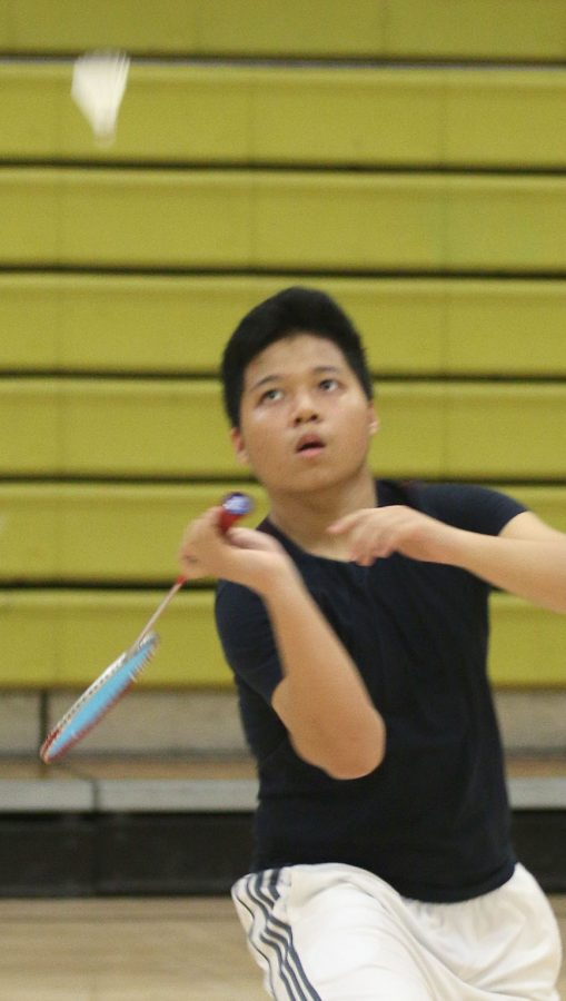 Senior+Eric+Smith+concentrates+not+only+on+hitting+the+birdie+but+on+adapting+to+his+new+home+on+and+off+the+court.+