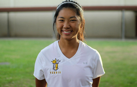 Senior Lyznie Vang poses for a picture in her uniform before a match.