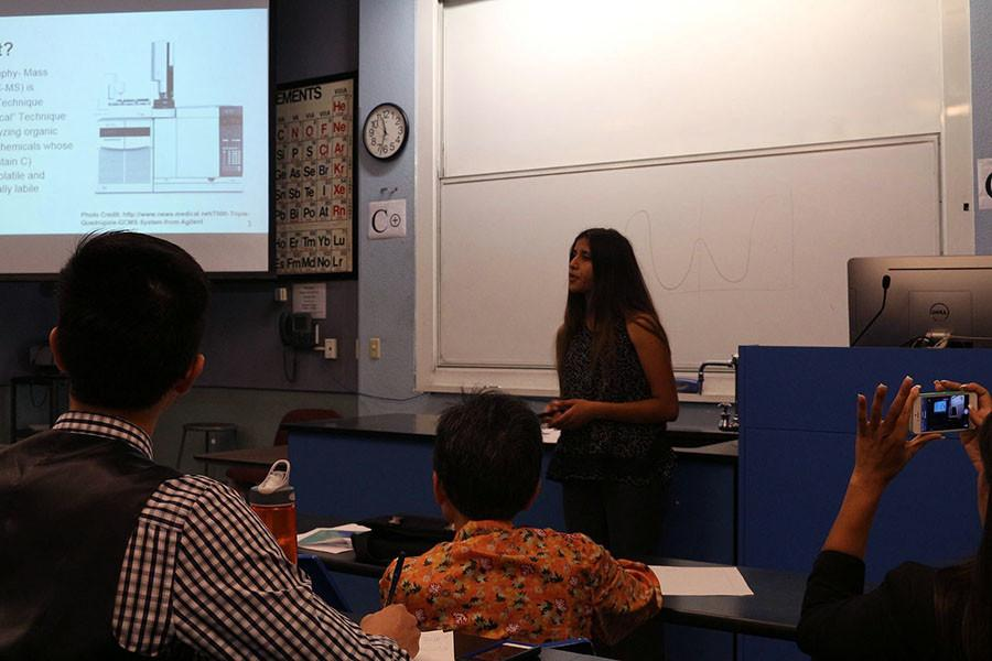 Former+student+Sereena+Nand+presents+her+end+project+on+her+research+in+front+of+SEED+professors%2C+sponsors+and+other+participants.
