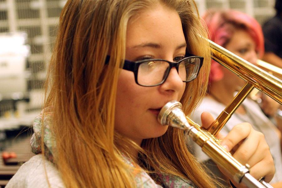 Freshman Krissi Dougherty takes a moment to breathe away from her trombone.