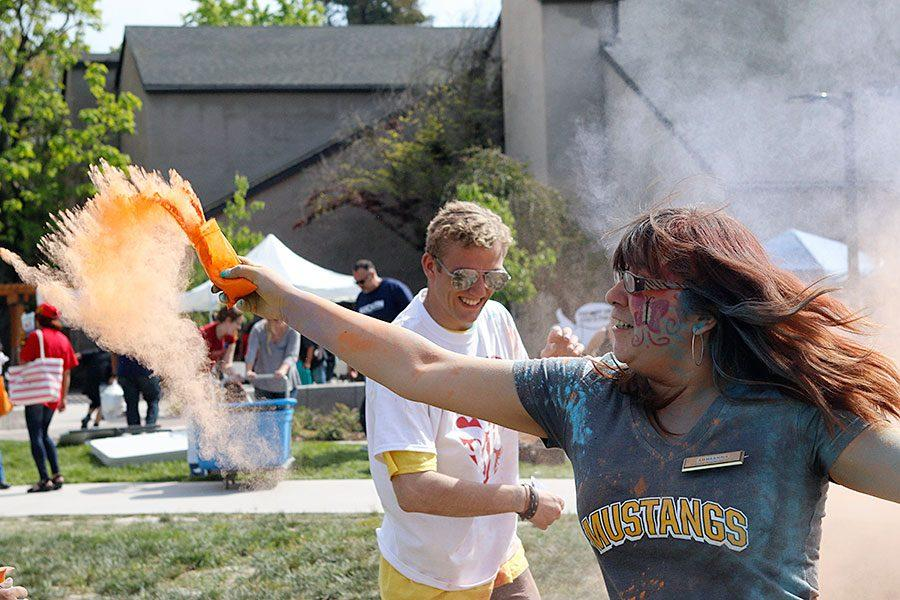 Young people throw dye powder packs at each other during the Stockton is Magnificent event that was held April 2.