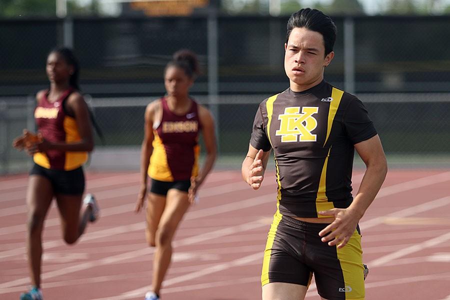 Sophomore Emmanuel Morales runs during the meet again Edison.
