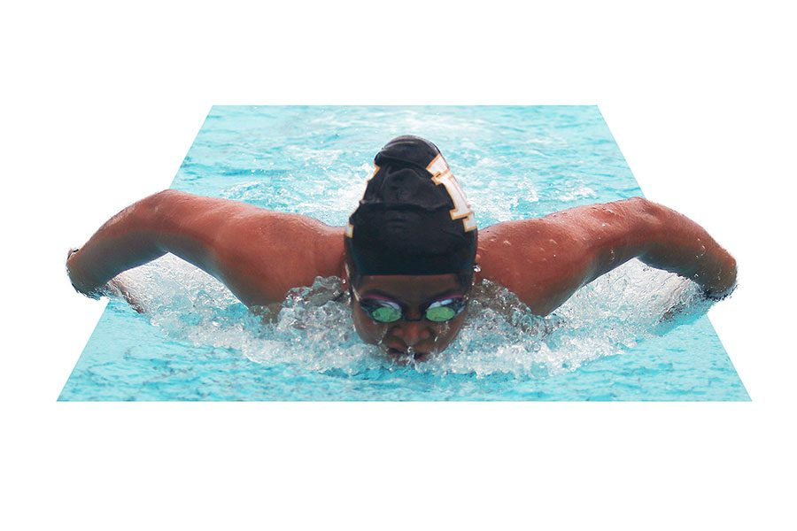 Senior Aja Reyes performs a butterfly stroke in her 100m fly race against Chavez. At the end of the meet Reyes took first place.