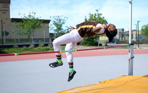 Sophomore Kieth Jenkins hurdles himself over the bar.