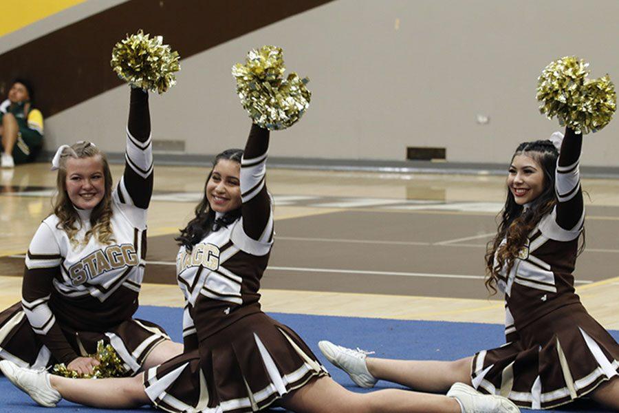 Juniors Heather Balcom , Anahi Solorio, Aline Arias , close out with split move .