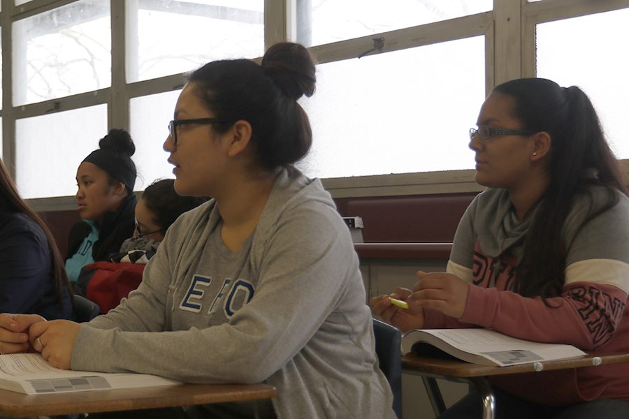 Junior Litzy Esparza and Vanessa Espino are listening to Natalie Frisks lecture about the SAT.