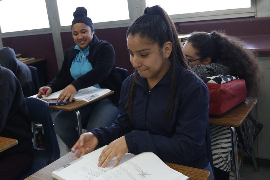 Junior Mariel Hernandez is reading a short passage along with her teacher.