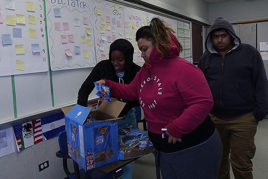 Juniors Tenyiah Washington and April Duran are caught picking up snacks during their ten minute break.