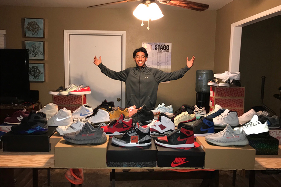 Michael Herrera, a senior, poses with his collection of shoes that he keeps at home.