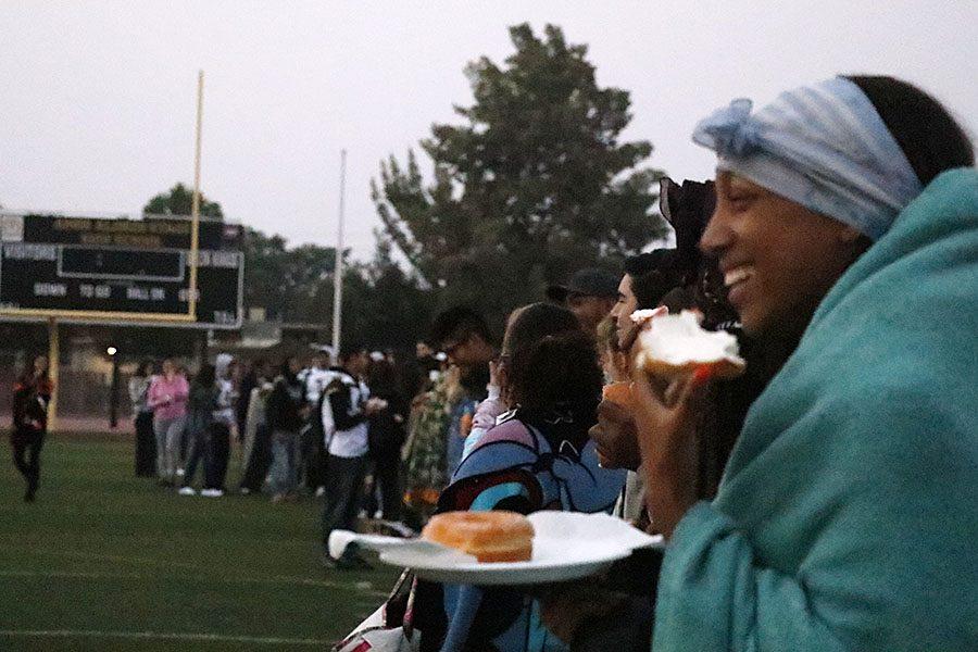Senior Antwanette Adger enjoys a bagel as she gets warmed up with her blanket.