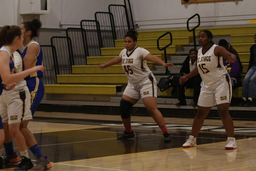 Jazzlyn and Janelle standing in defense position lookout for Lindens offense.