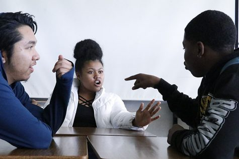 photo by Solomon juarezSeniors Kaitlynn Ford and Gabriel Hernandez and freshman Maurice Cheatum do an improv exercise as a warm-up for their sixth period Drama class. They were in a library and the two guys were arguing over who is the father of the girl's baby.
