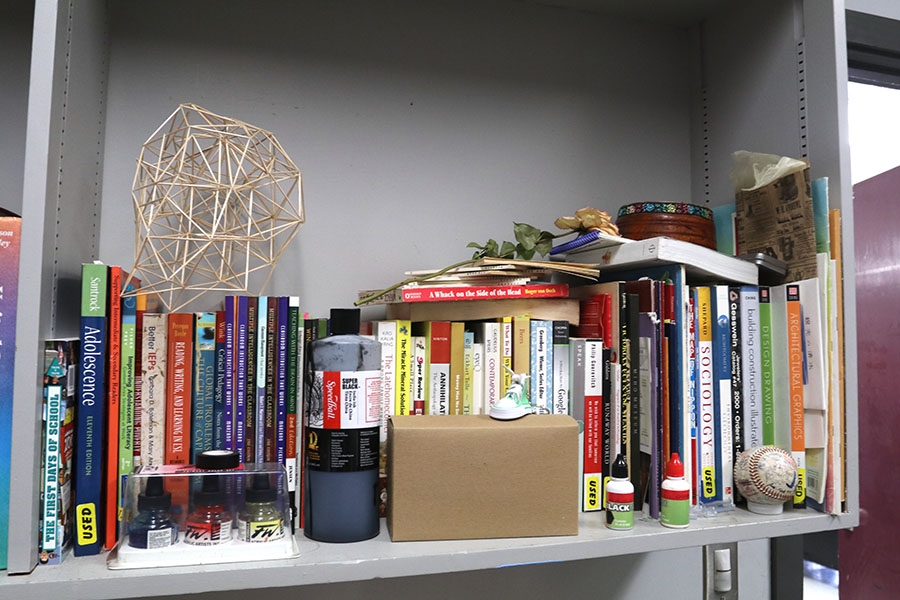 Vang+continues+to+study+and+read+the+many+art+books+he+collects.