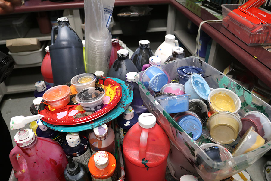 An+assortment+of+paint+is+left+in+the+middle+of+Vang%27s+back+room.+They+are+often+leftover+paints+used+by+his+previous+class.+