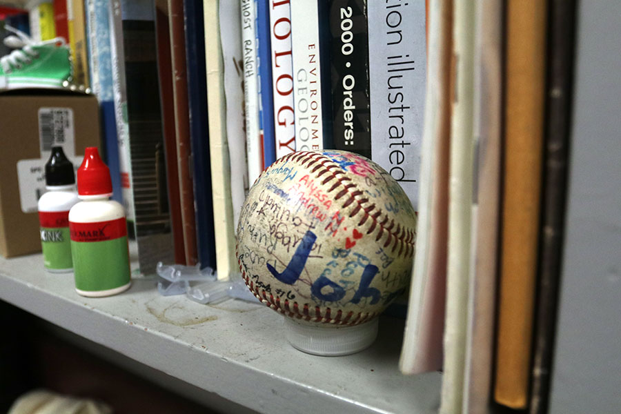 Vang+contains+this+baseball+as+a+memento+to+the+previous+years+he+has+taught+at+Stagg.