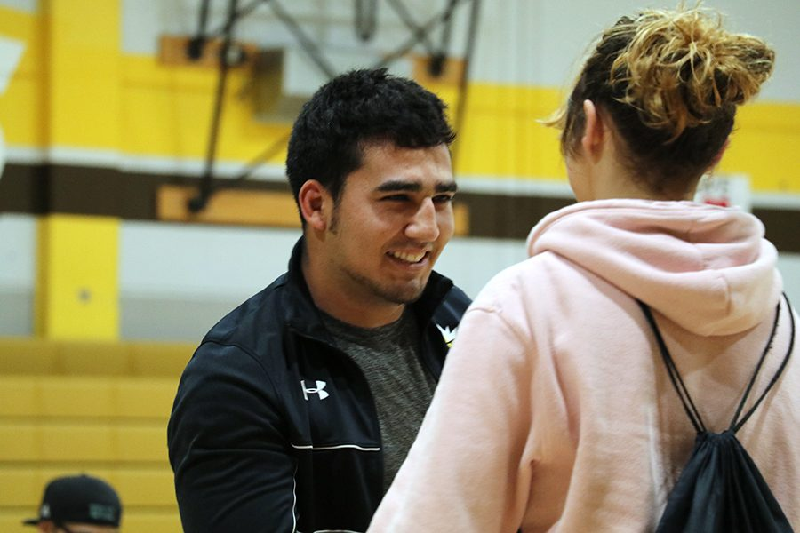 Assistant wrestling coach Miguel  Coyt gives Freshman Katalina Danforth her most improved player award.