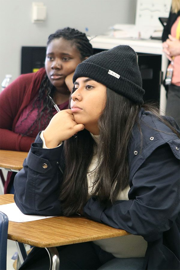 Junior Annaly Bautista, is very engaged in the presentation.