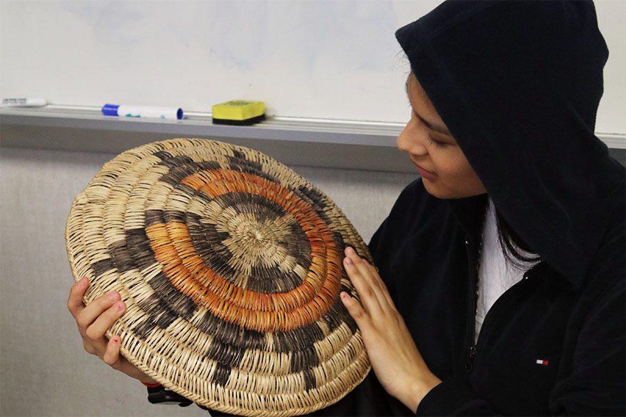 Junior Annabella Ayala Grande takes a look at a Navajo Basket.