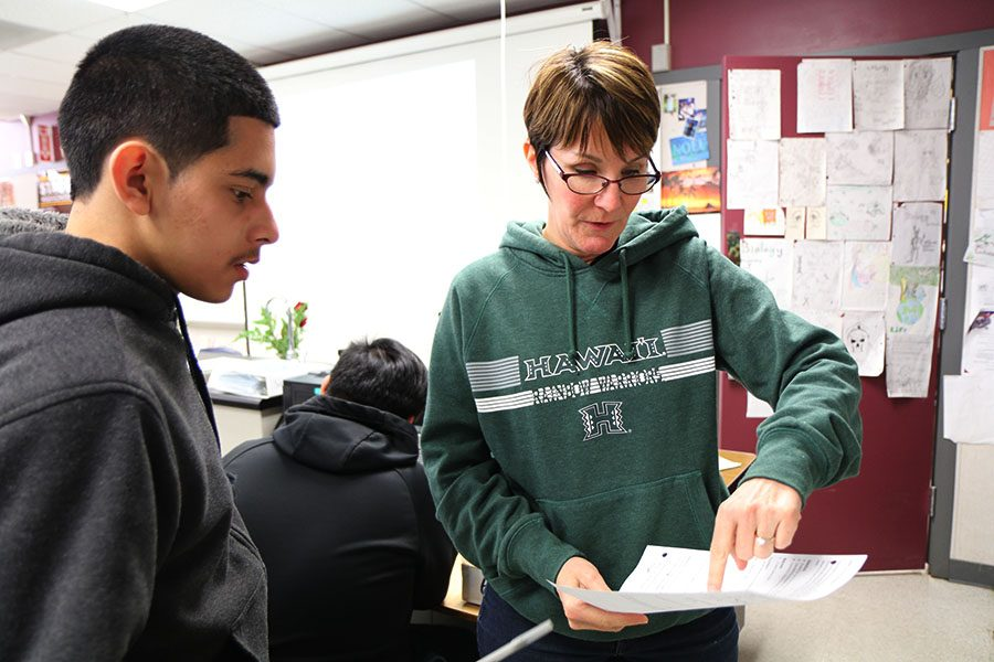 Sophomore Julian Bautista asks biology teacher Marry Martin about how probability works.