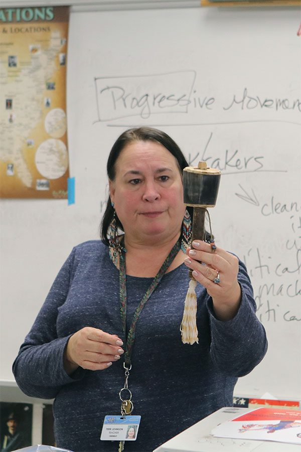 Mrs. Johnson shows the class what a Native-American Rattle looks like to the class.