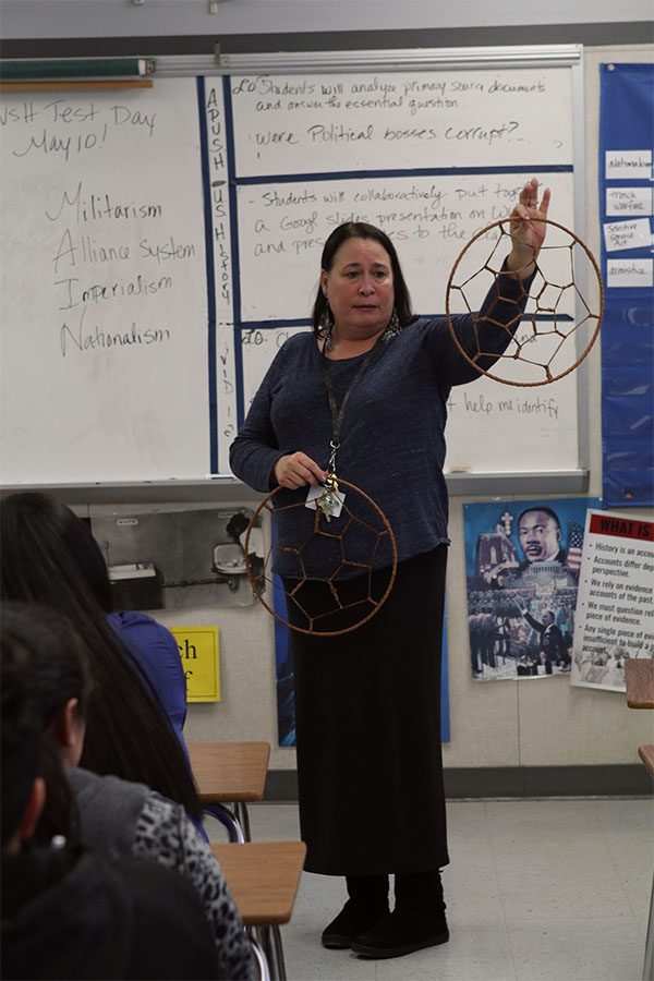 Mrs.+Johnson+explains+to+students+how+the+spear+hoops+work+and+how+they+are+incorporated+in+games.