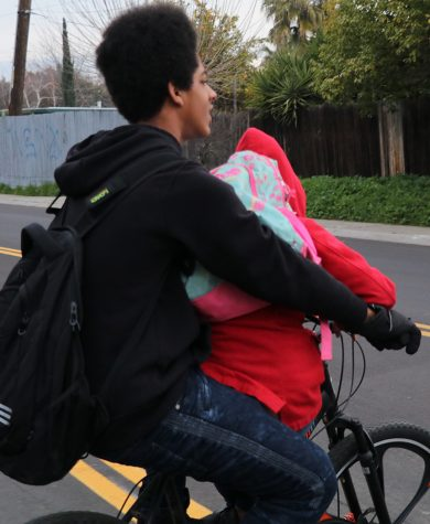Freshman Elijah Ali drops his little cousin off every morning at Tyler Skills Elementary before going to Stagg. His cousin needs to sit on the handle bars of the bike in order to have room for both of them.