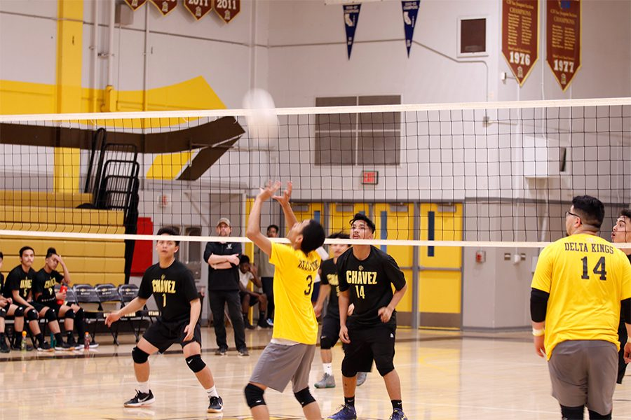 James Chom prepares to set the ball to the middle hitter in hope of a spike.