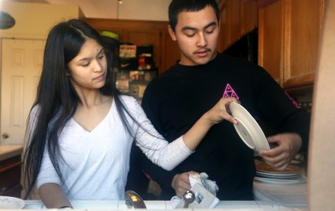 Seniors Mariele Jones and Marcelo Sarcos contribute to their home by cleaning, washing dishes, and helping around. They figure that if they split the work they could have more free time to do other things such as watching movies or playing video games.