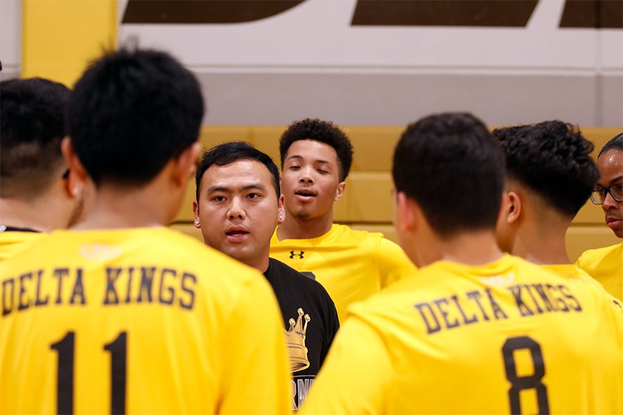 Coach Jeremy Moua, encourages his team to push through the second match and work  as one.