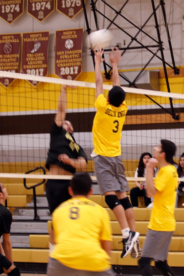 Senior James Chom, blocks the ball from Chavez's  outside hitter, gaining Stagg another point.