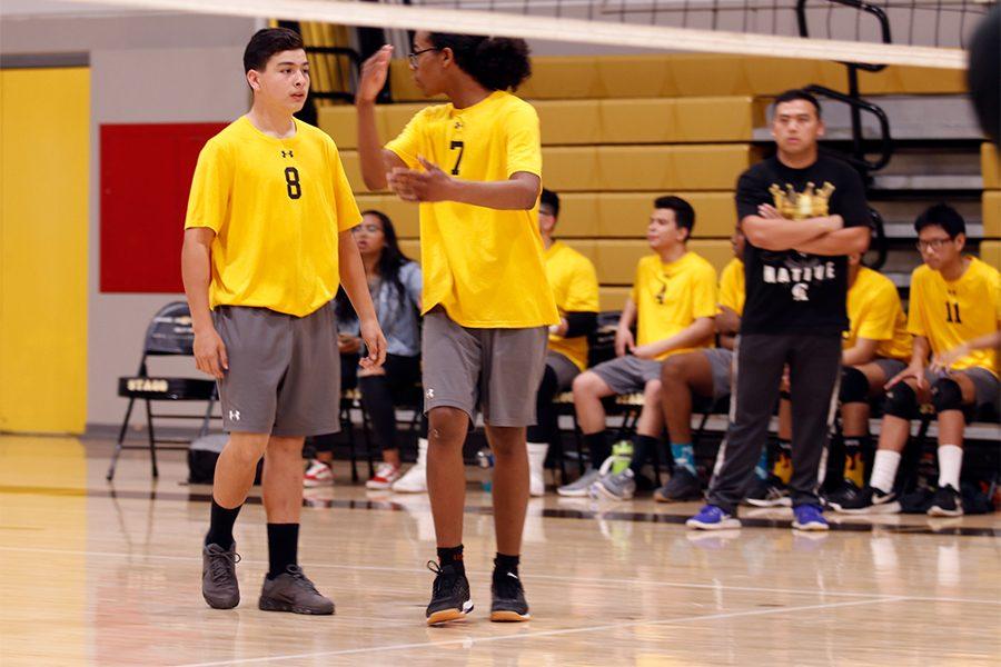 Senior Keijuan Desoto gives a pep talk to his teammate, freshman David Gutierrez.