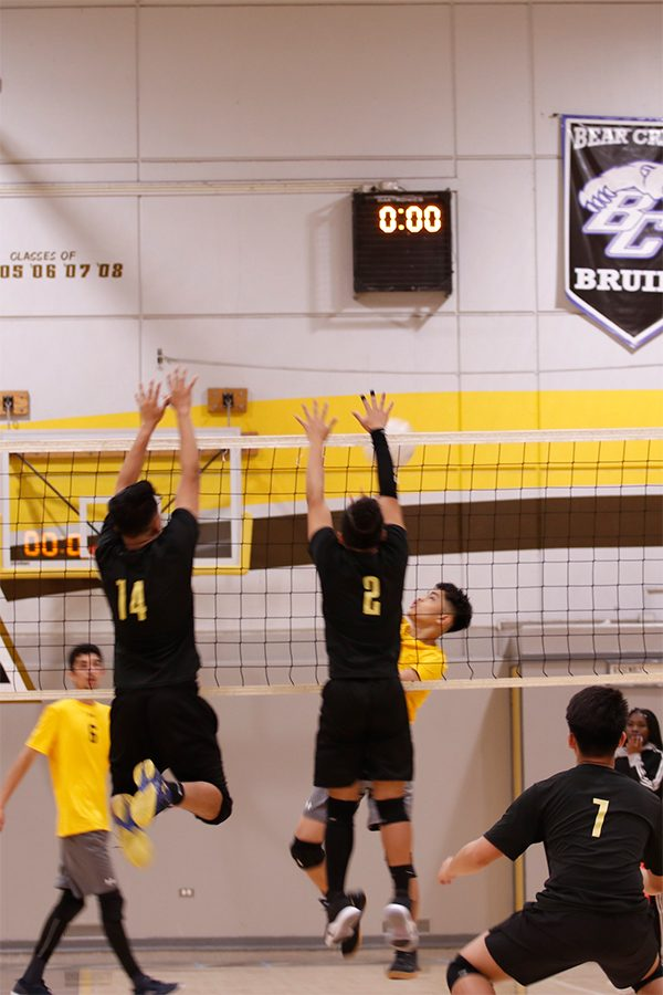 Sophomore Rodney Morco attempts to spike the  ball, but ends up getting blocked by Chavez.