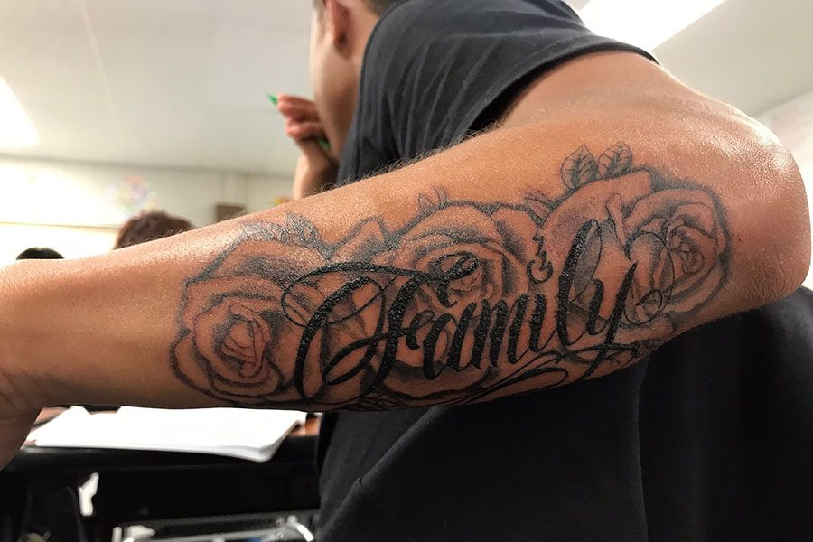 Junior Craig Barber, as a first tattoo, decided to get a symbol of significance, and also decides to add roses because of his mother.