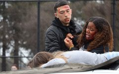 Seniors Enekeyo Sakata and Tenyiah Washington, two of the actors that were involved in the car crash, struggle to wake their friend Marissa Pimentel up. Pimentel was pronounced dead on the scene.