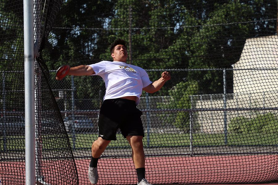 Sophomore Roman Ameperosa, is about to release the discus. His  distance is 116m.