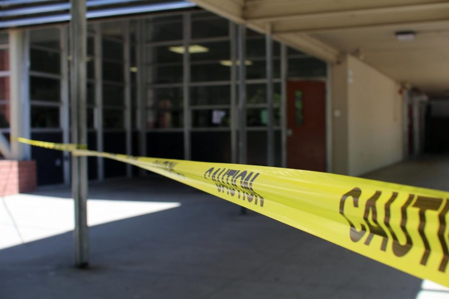 Caution tape to keep students from entering the now renovating cafeteria.