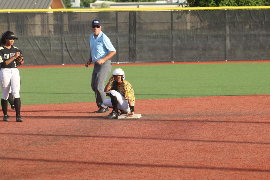 Senior Mariele Jones casually relaxes on second base after hitting a double