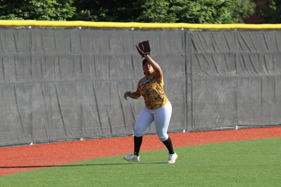 Senior Danna Gallon,  catching a fly ball in the outfield