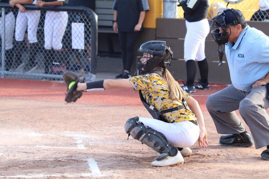 Sophmore Carlie Rodriguez as catcher, receiving a fierce pitch for a strike