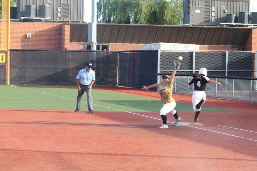 Senior Carly Ruiz barely misses a overthrown ball towards first base