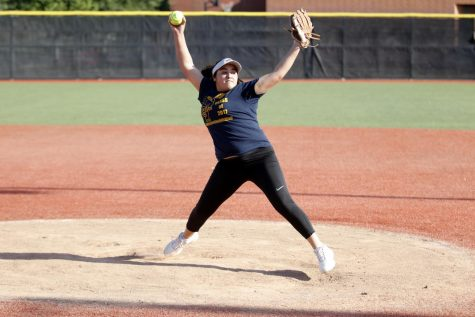 Junior Laurenne Dominguez practices pitching in preparation for an away game against Edison. The Delta Queens went on to win that game 7-6.