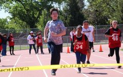 Special needs students from multiple schools came to Stagg to participate in the Special Olympics held on April 12. A student from Stagg is in the lead while the others attempt to  catch up.