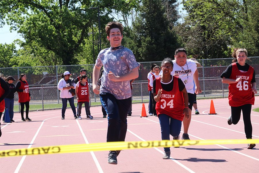Special+needs+students+from+multiple+schools+came+to+Stagg+to+participate+in+the+Special+Olympics+held+on+April+12.+A+student+from+Stagg+is+in+the+lead+while+the+others+attempt+to++catch+up.+