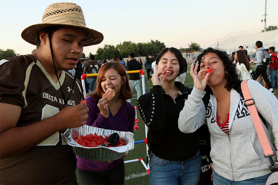 Students+enjoying+watermelon+for+breakfast.+