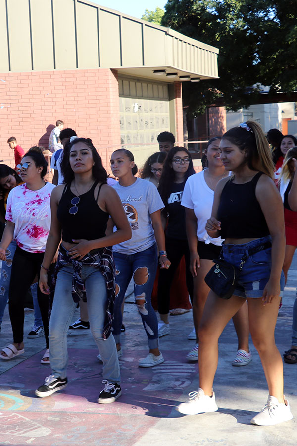 Seniors+Andrea+Tello+and+Annabelle+Pike++lead+the+group+to+The+Cupid+Shuffle.+