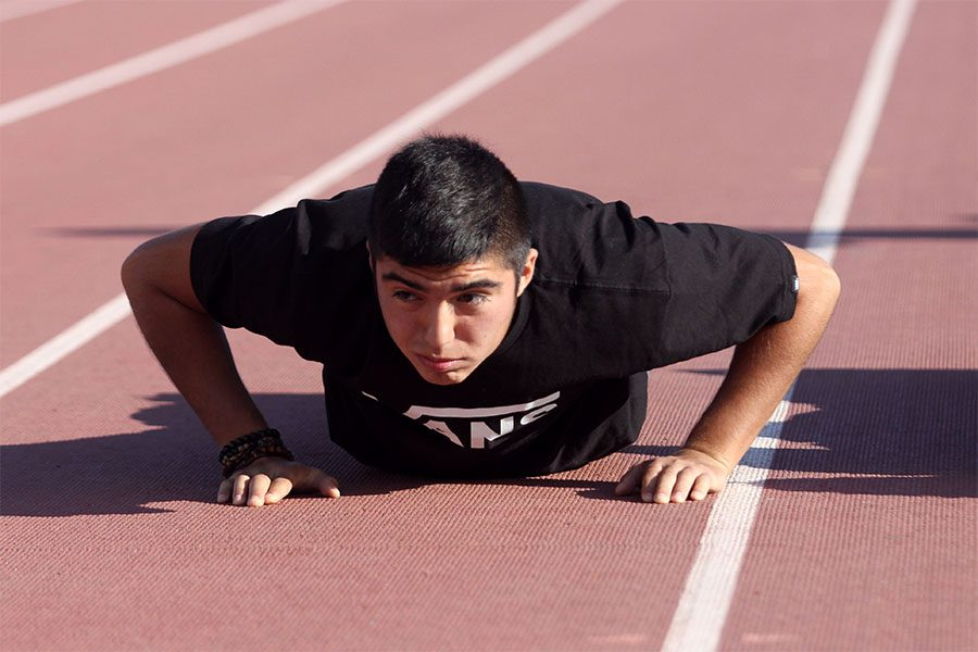 Senior Josh Cortez shows determination while doing push-ups.
