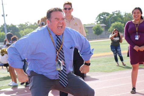 Principle Gary Phillips shows expression during his dance off against the other teachers.